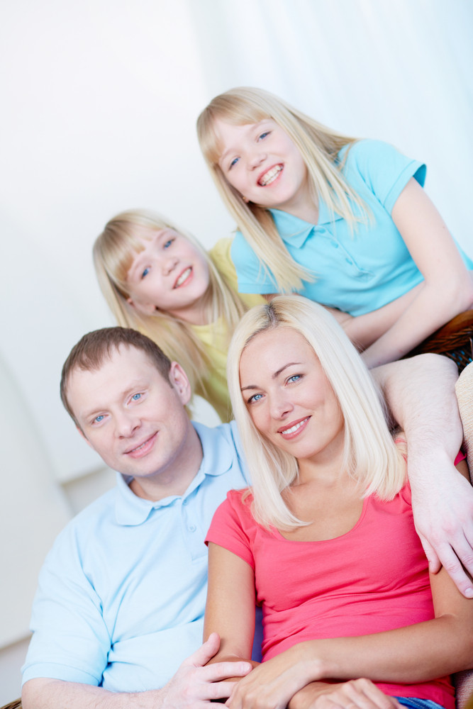Portrait Of Parents And Children Looking At Camera