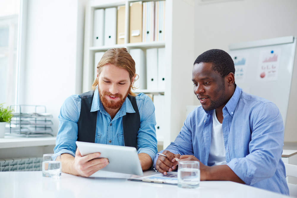 Two Businessmen In Casual Networking In Office