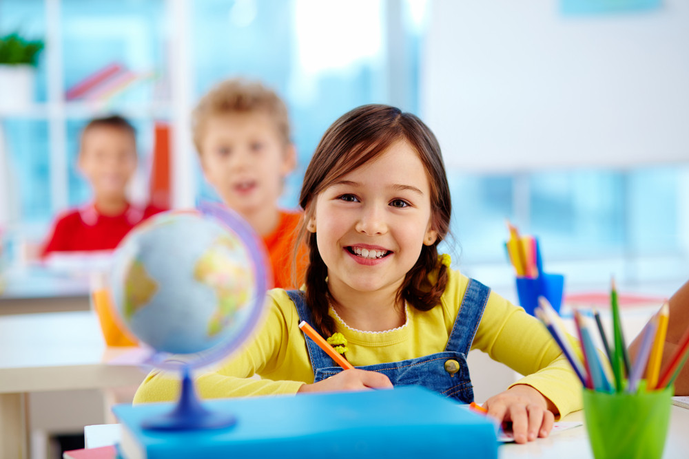 Image Of A Cute Pupil With Cheerful Smile