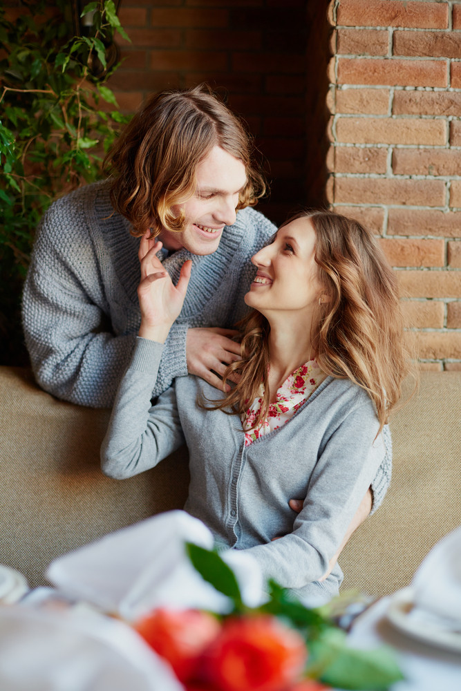 Portrait Of Amorous Young Couple Looking At One Another