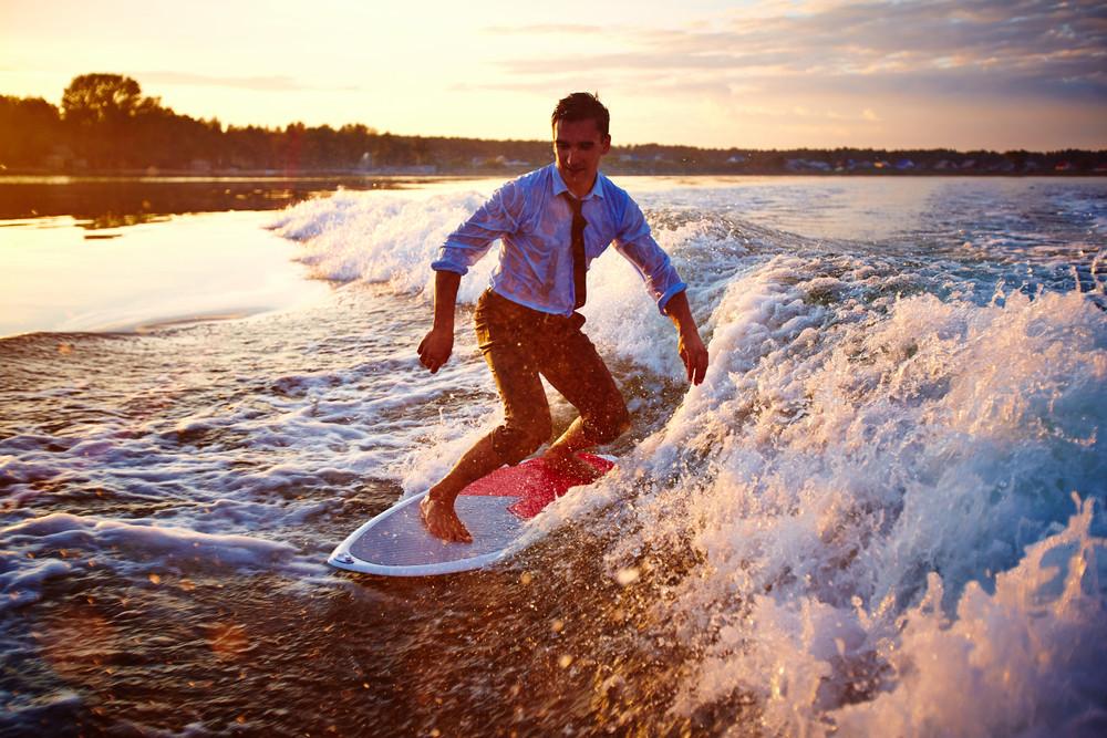 Attractive Sportsman Surfboarding At Summer Resort