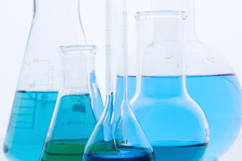 Image Of Several Flasks With Blue Liquid In Laboratory