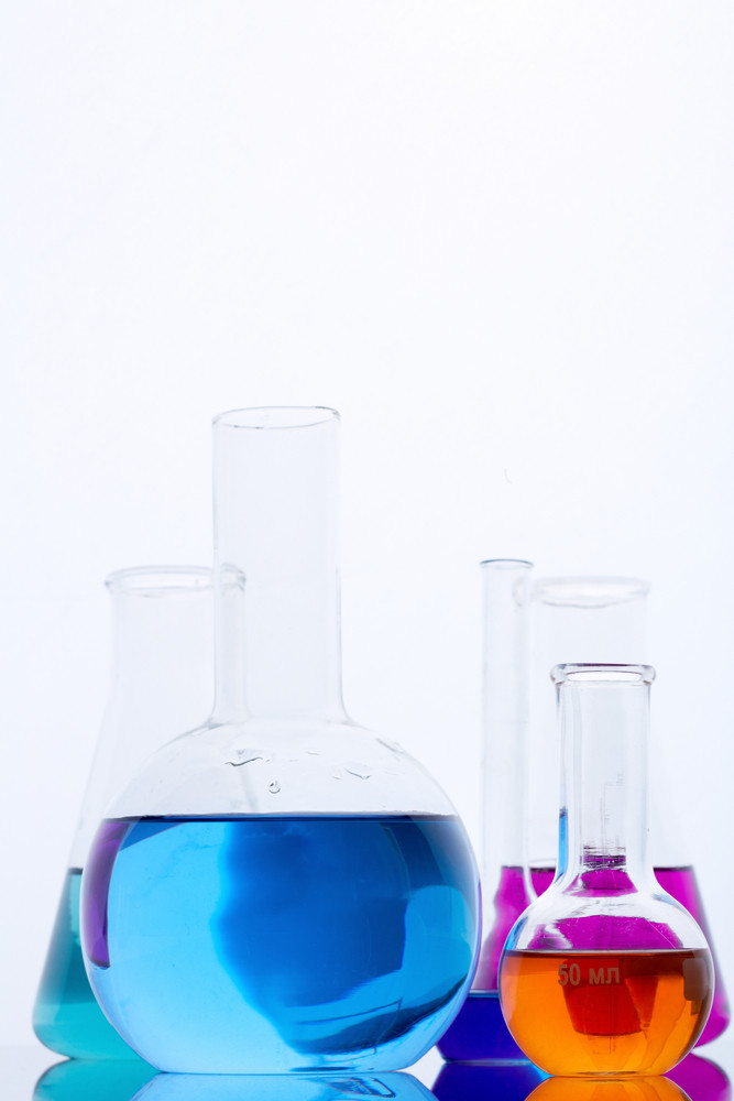 Image Of Several Flasks With Multi-color Liquids In Laboratory