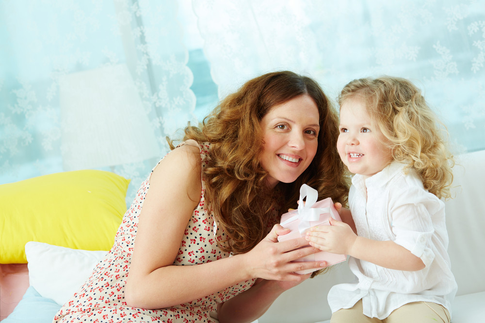 Kind Mother Giving Her Daughter Small Present In Giftbox
