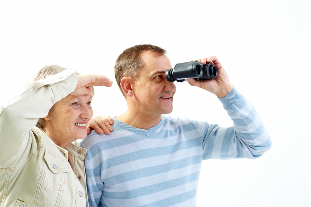 Portrait Of Happy Senior Couple Looking For Travel
