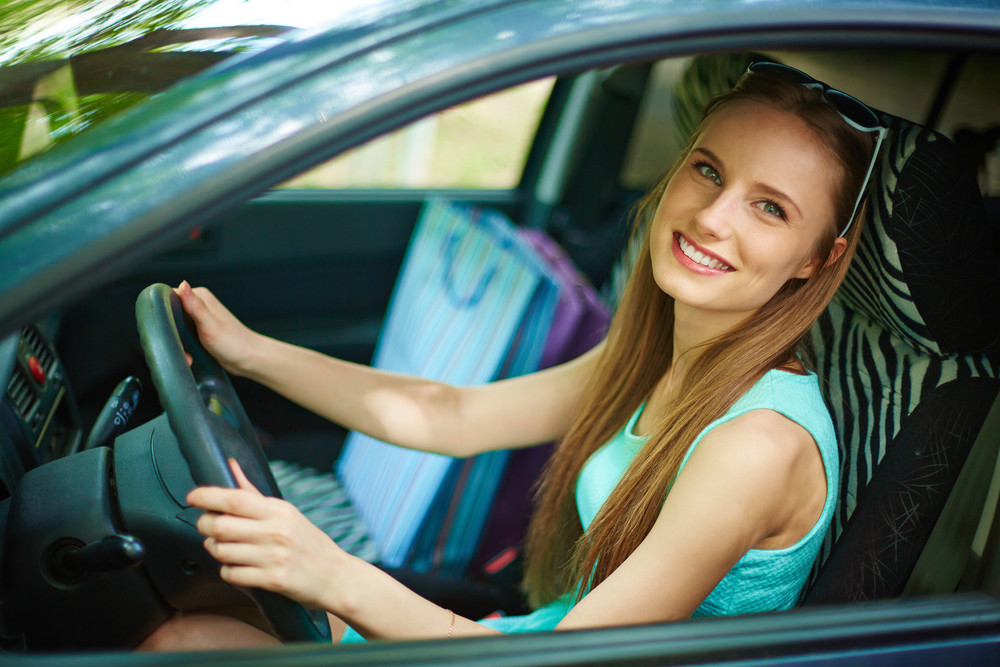 Photo Of Happy Woman Looking At Camera From Car Window