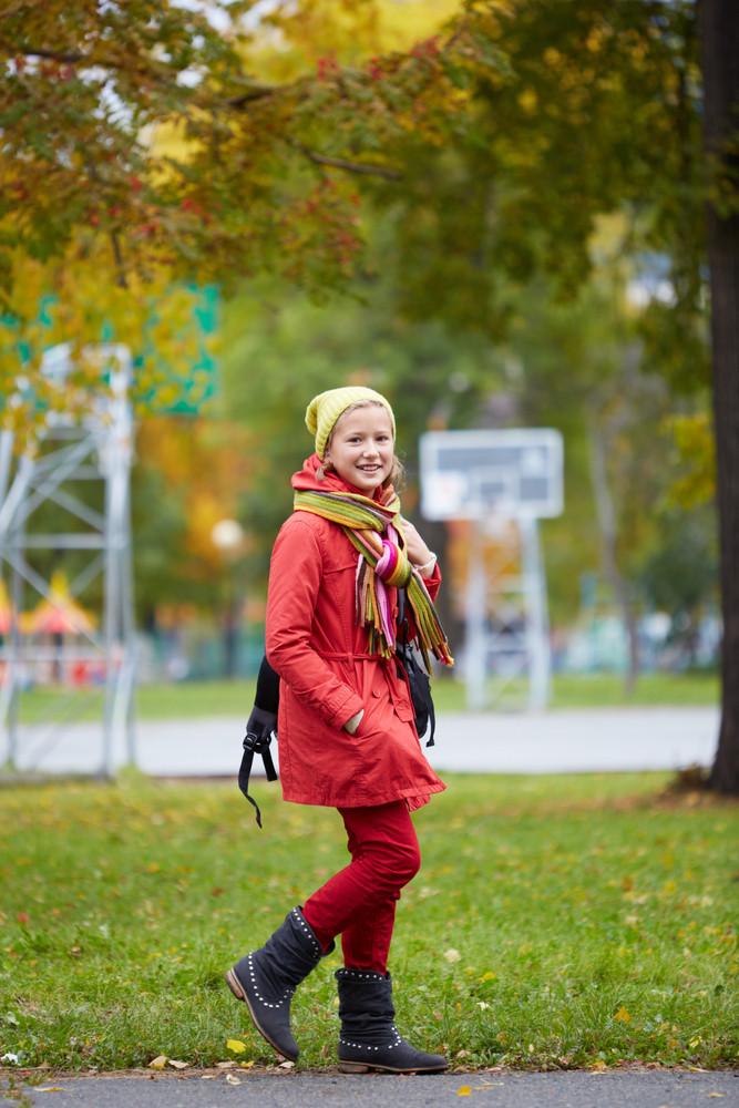 Portrait Of Happy Schoolgirl Going To School