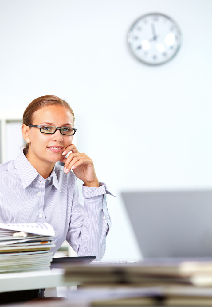 Portrait Of Smart Businesswoman Looking At Camera In Office