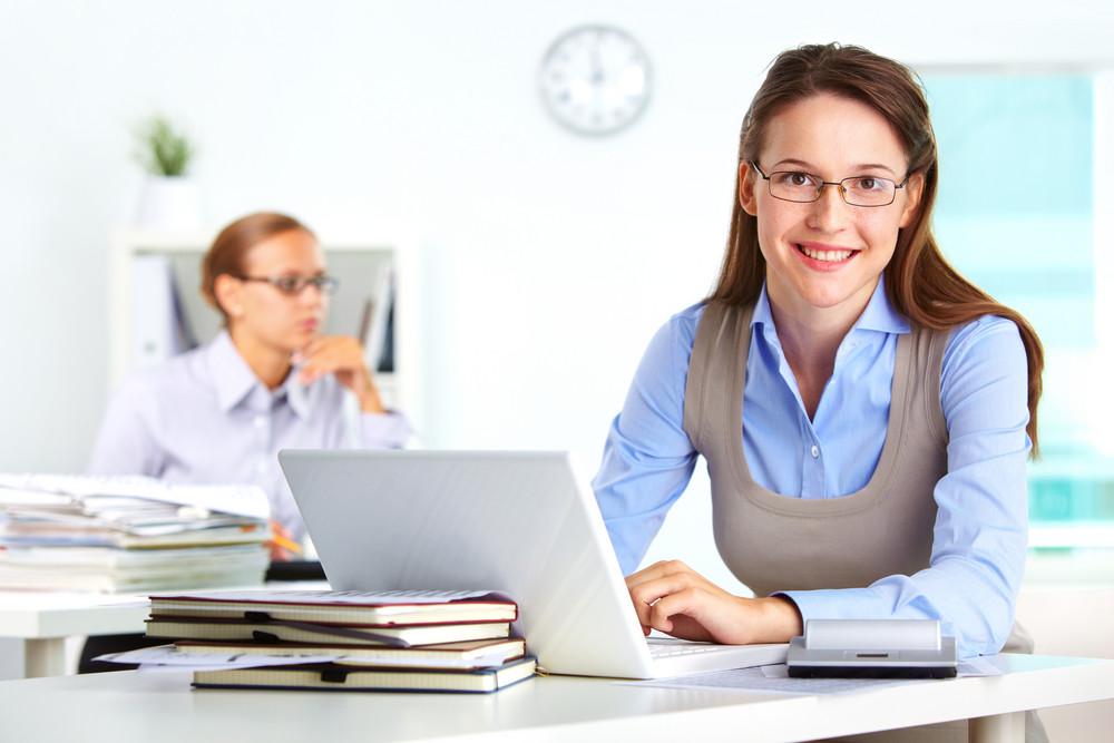 Portrait Of Pretty Secretary Using Laptop In Office