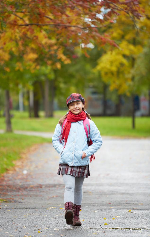 Portrait Of Happy Schoolgirl In Casual Going To School