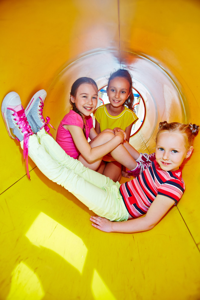 Image Of Happy Little Girls Looking At Camera While Enjoying Leisure