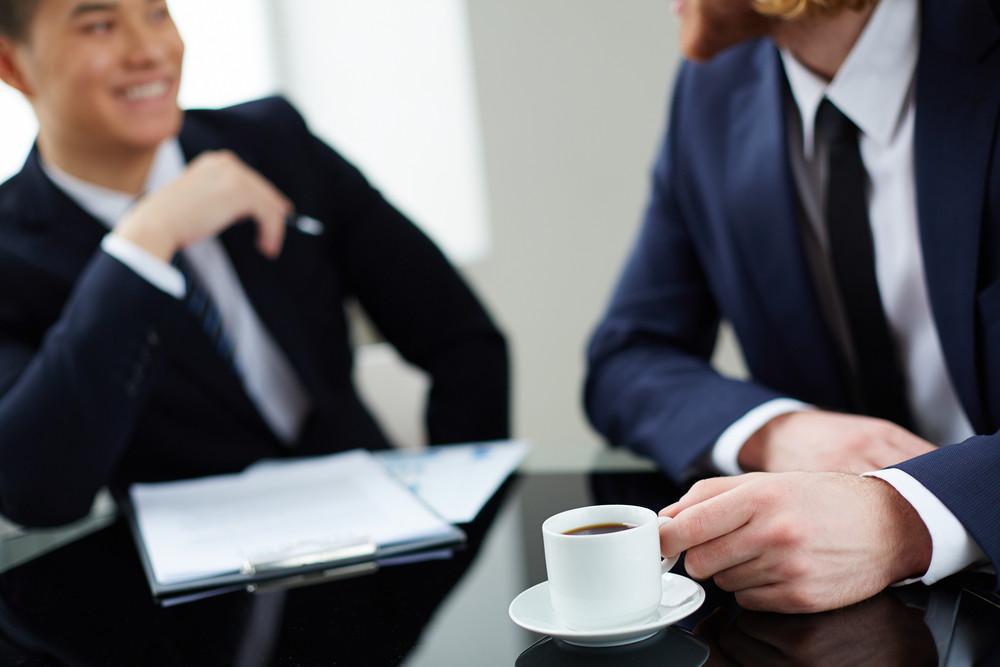 Two Successful Entrepreneurs Interacting At Meeting