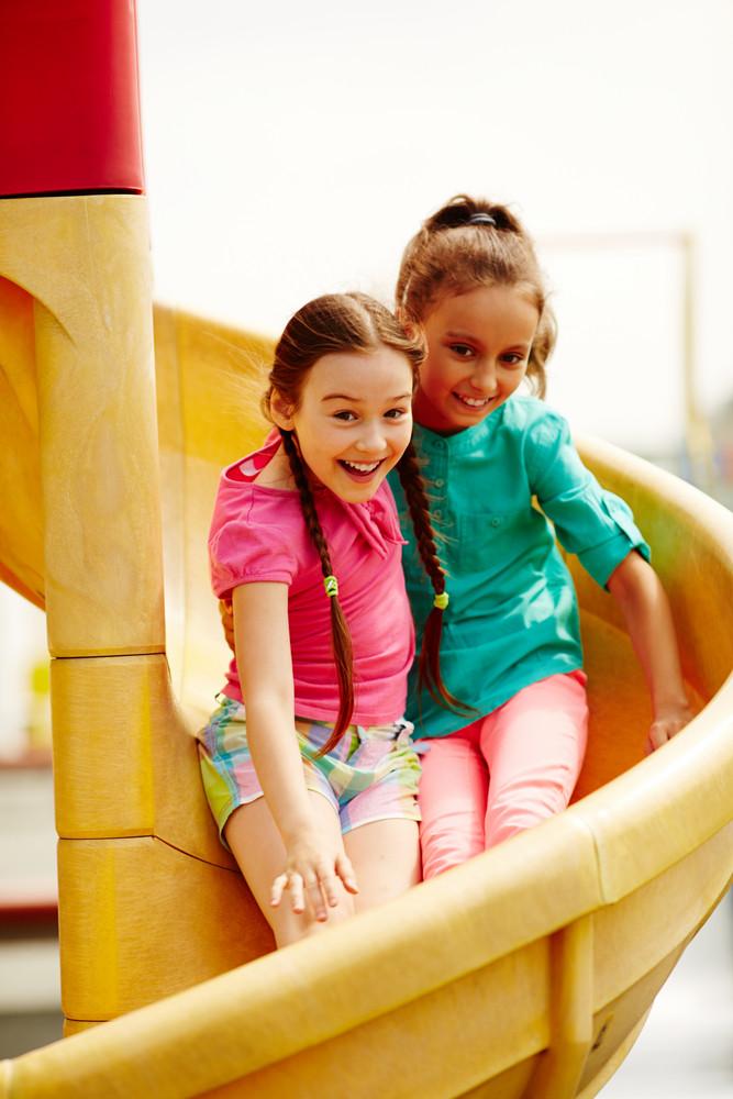 Image Of Cute Girls Having Fun On Playground