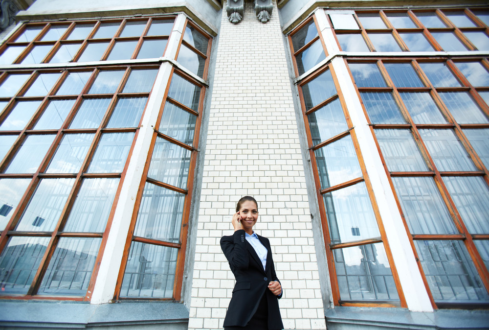 Image Of Happy Businesswoman Posing By Modern Building Outdoors