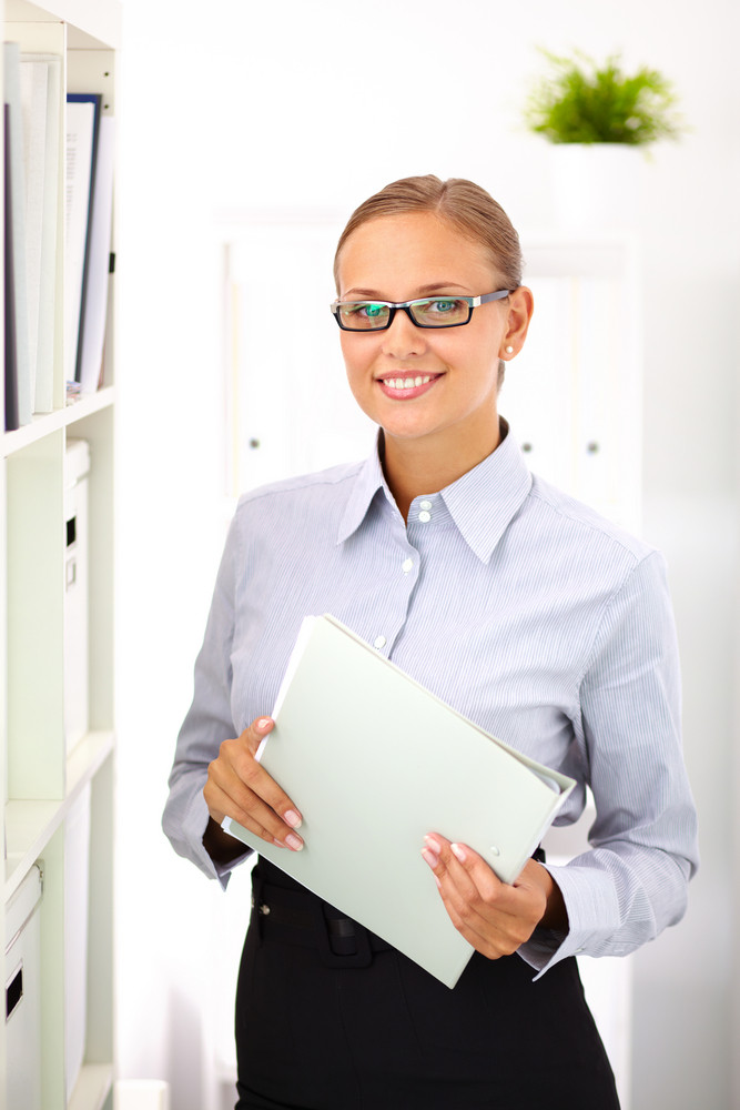 Vertical Portrait Of A Beautiful Corporate Worker Smiling At Camera