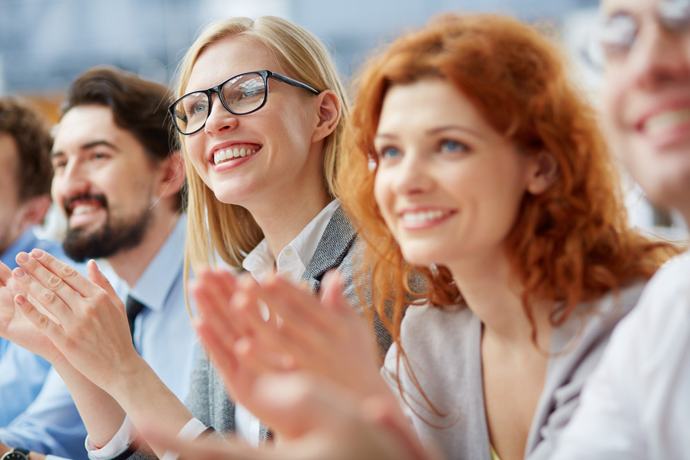 Photo Of Happy Business People Applauding At Conference