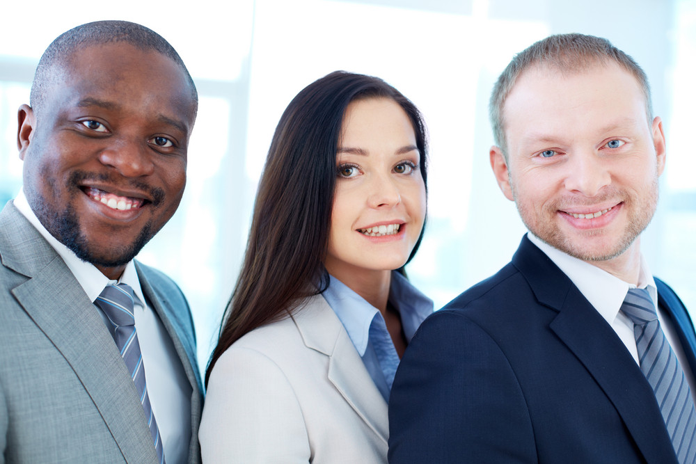 Portrait Of Smiling Business Partners Looking At Camera