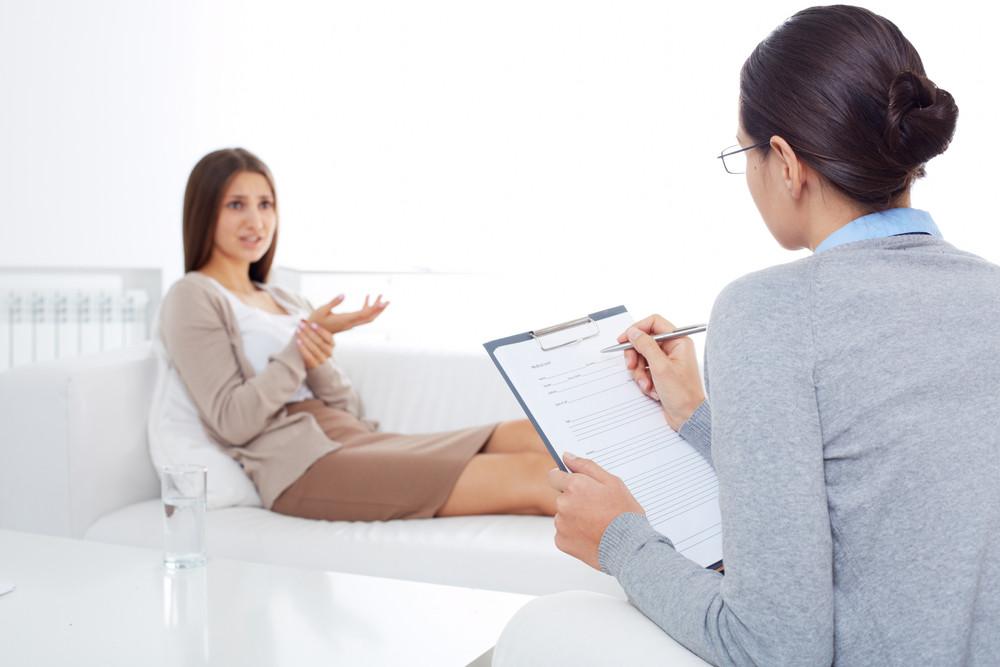 Upset Patient Describing Her Problem To Psychiatrist In Clinic