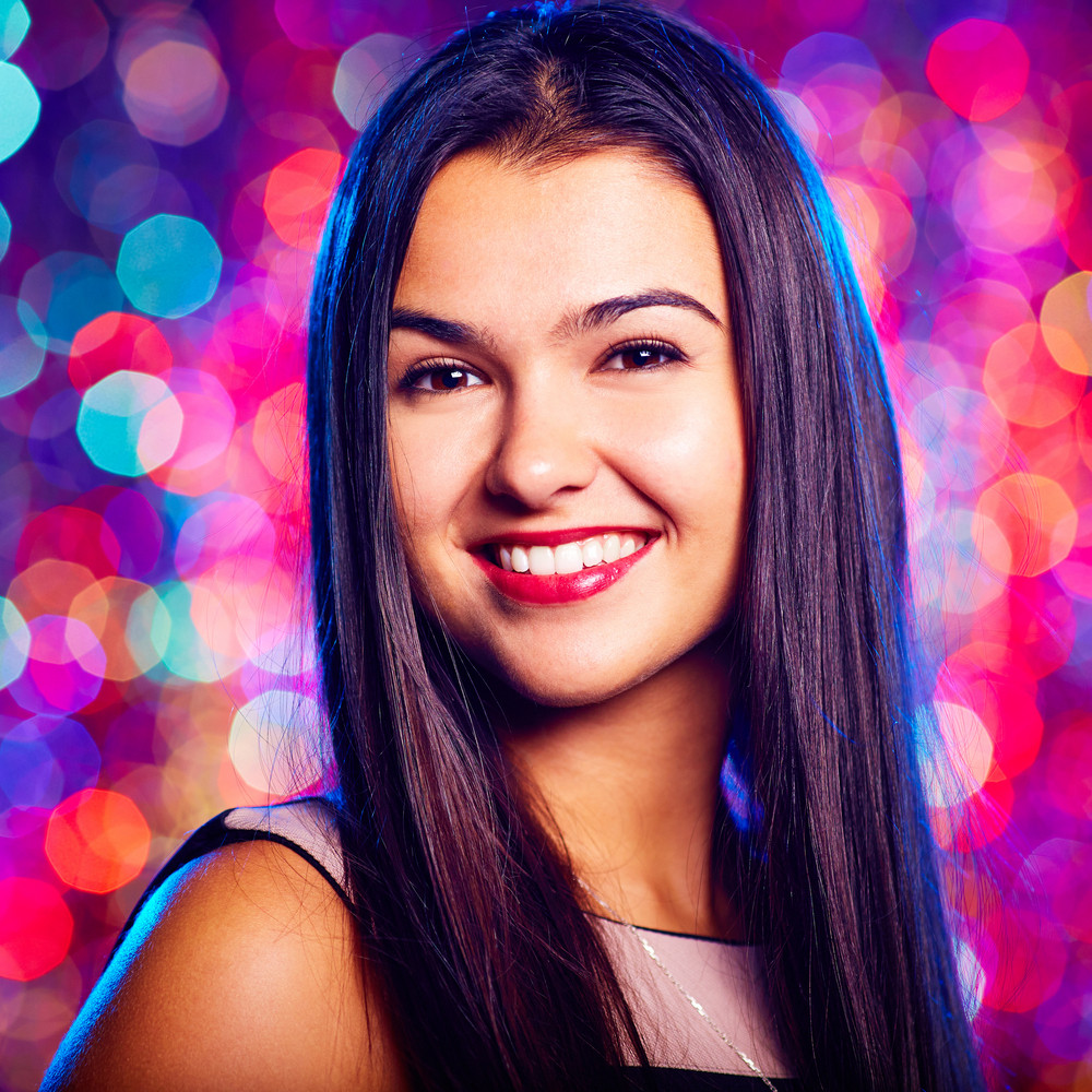 Portrait Of Cool Girl With Toothy Smile Enjoying Party In Nightclub
