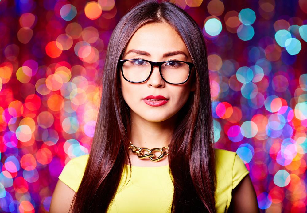 Stylish Asian Girl Over Sparkling Background