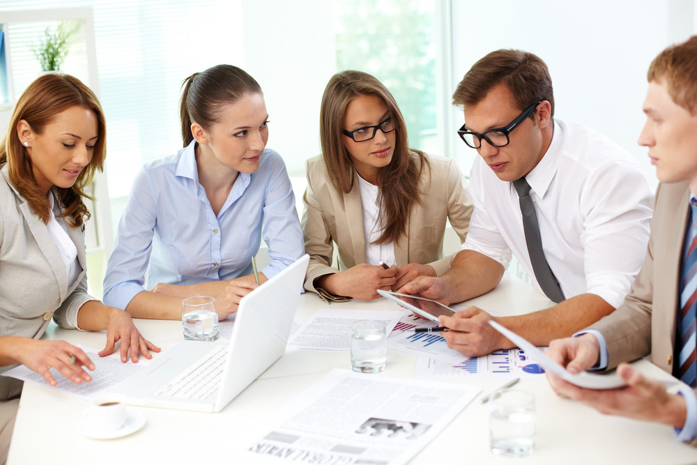 Business Colleagues Analyzing The Results Of The Financial Period Together