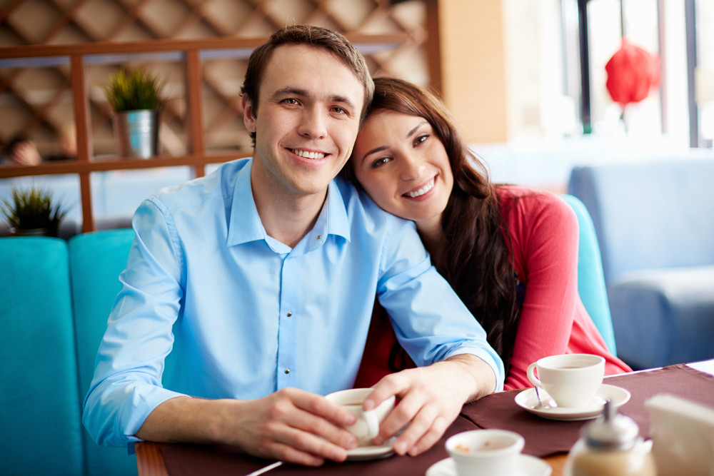 Portrait Of Amorous Young Couple Having Coffee In Cafe