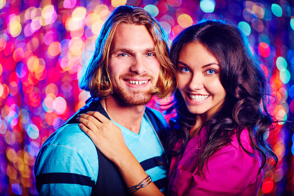 Affectionate Couple Dancing At Party Over Sparkling Background