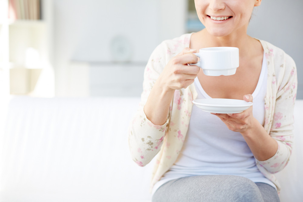 Image Of Young Smiling Woman Drinking Tea