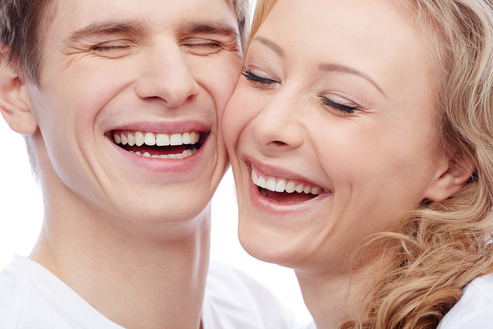 Faces Of Amorous Young Couple Laughing With Closed Eyes