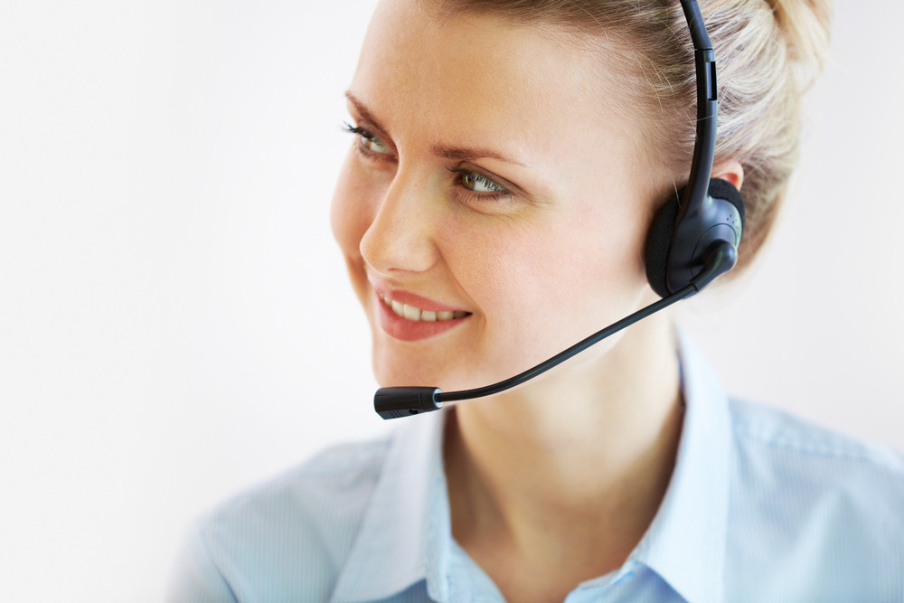Portrait Of A Friendly Customer Support Representative Being Ready To Help