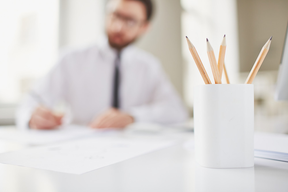 Image Of Several Pencils On Background Of Working Businessman