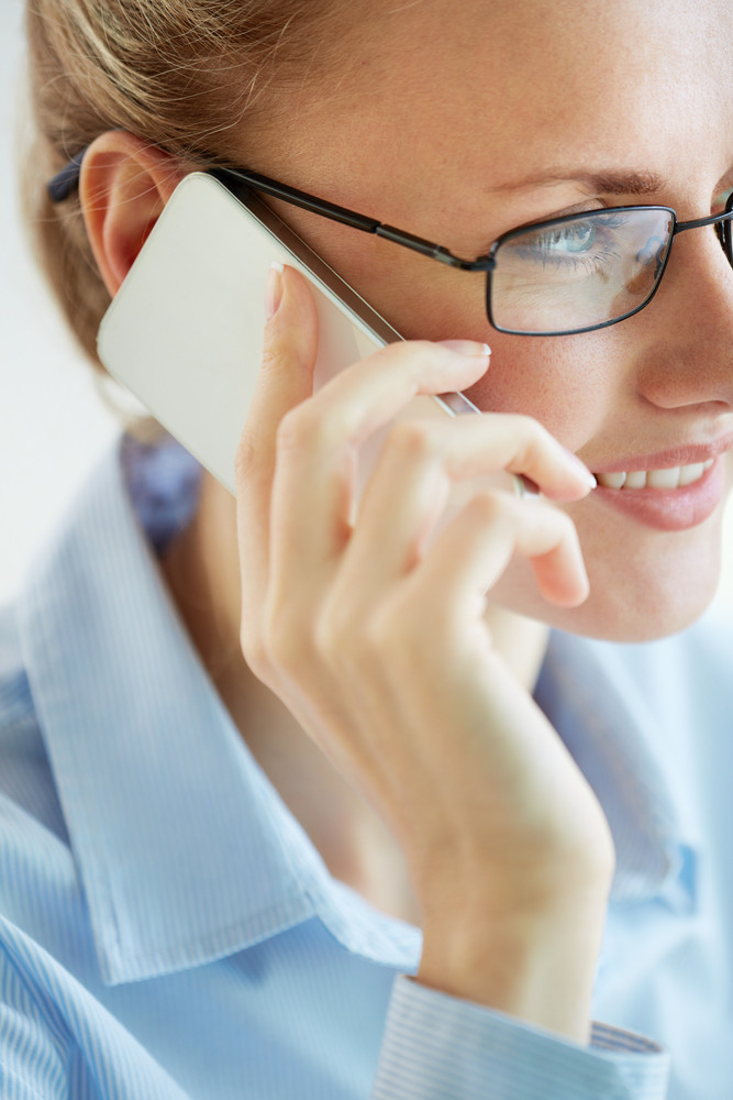 Vertical Image Of A Lovely Business Lady Making An Important Call
