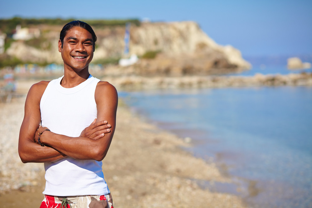 Happy Young Man Having Rest By The Seaside