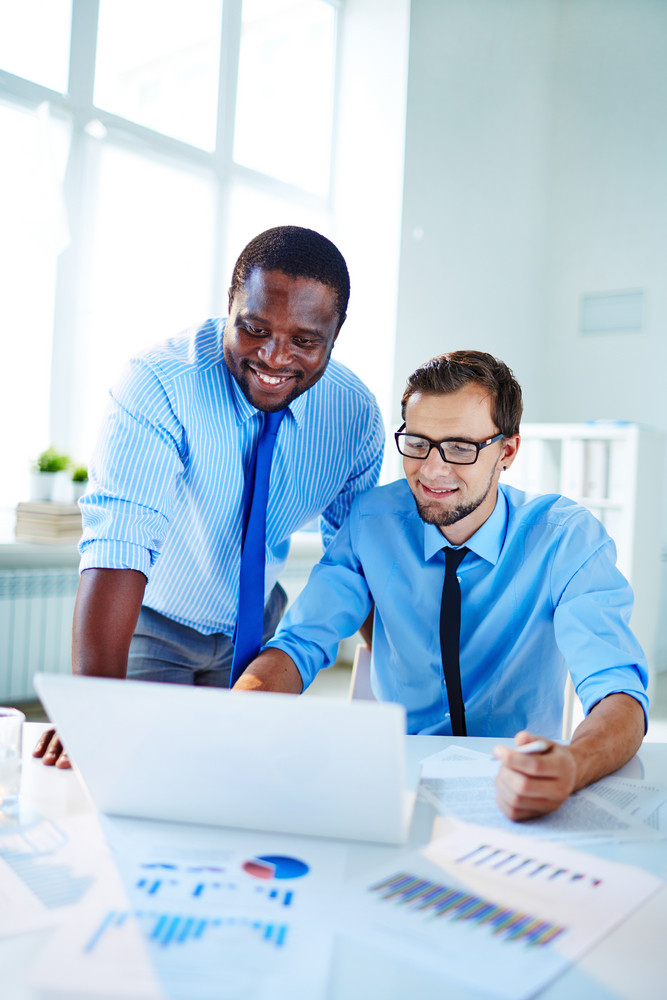 Two Confident Employees Networking At Meeting