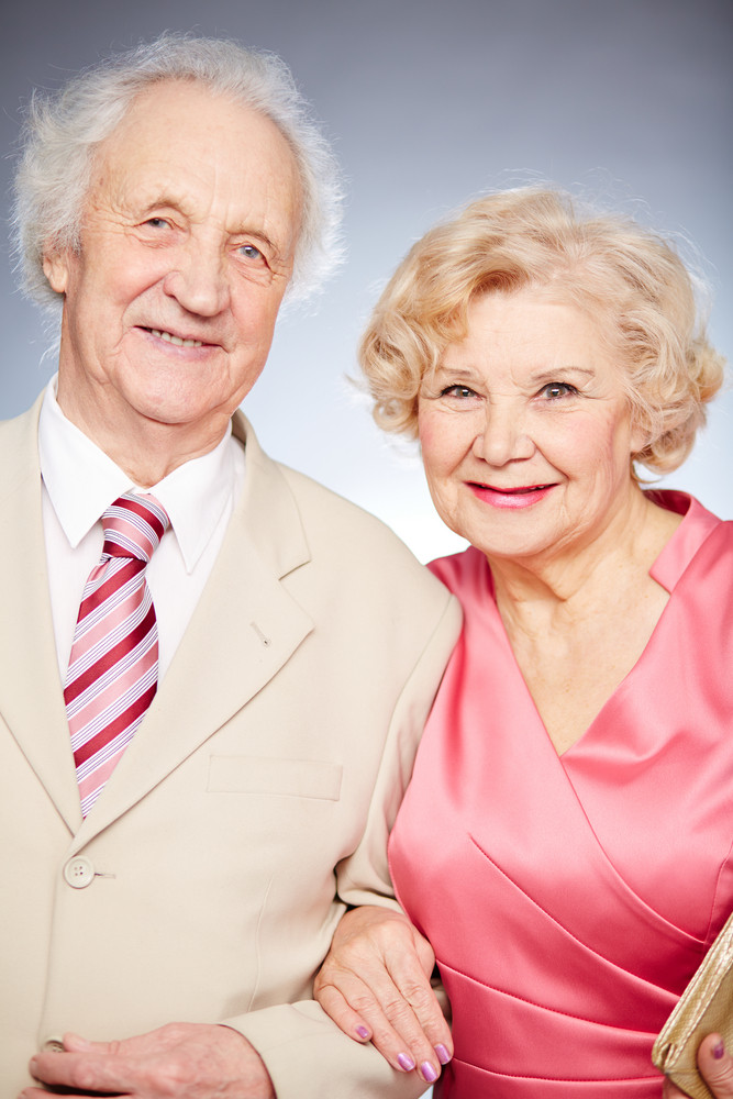 Portrait Of A Charming Retired Couple Posing In Isolation