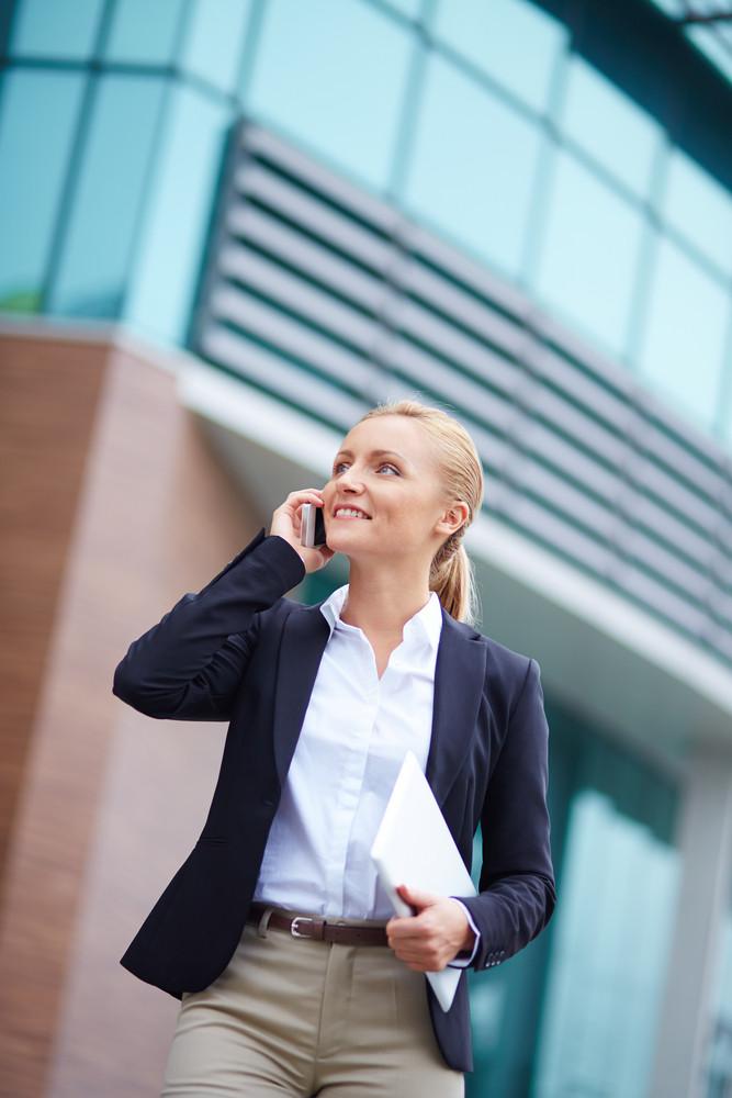 Portrait Of Elegant Businesswoman Speaking On The Cellular Phone Outside