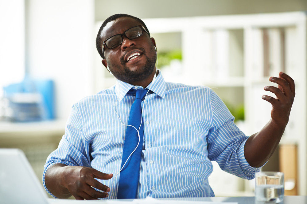 Image Of Young Businessman Taking Pleasure In His Favourite Music In Office