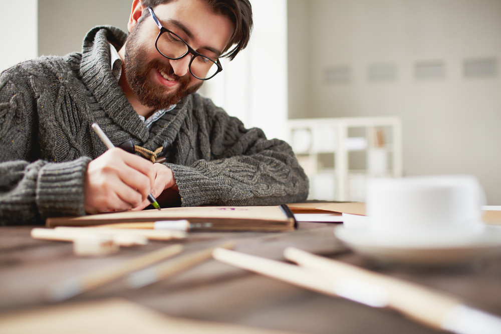 Image Of Happy Young Man Drawing
