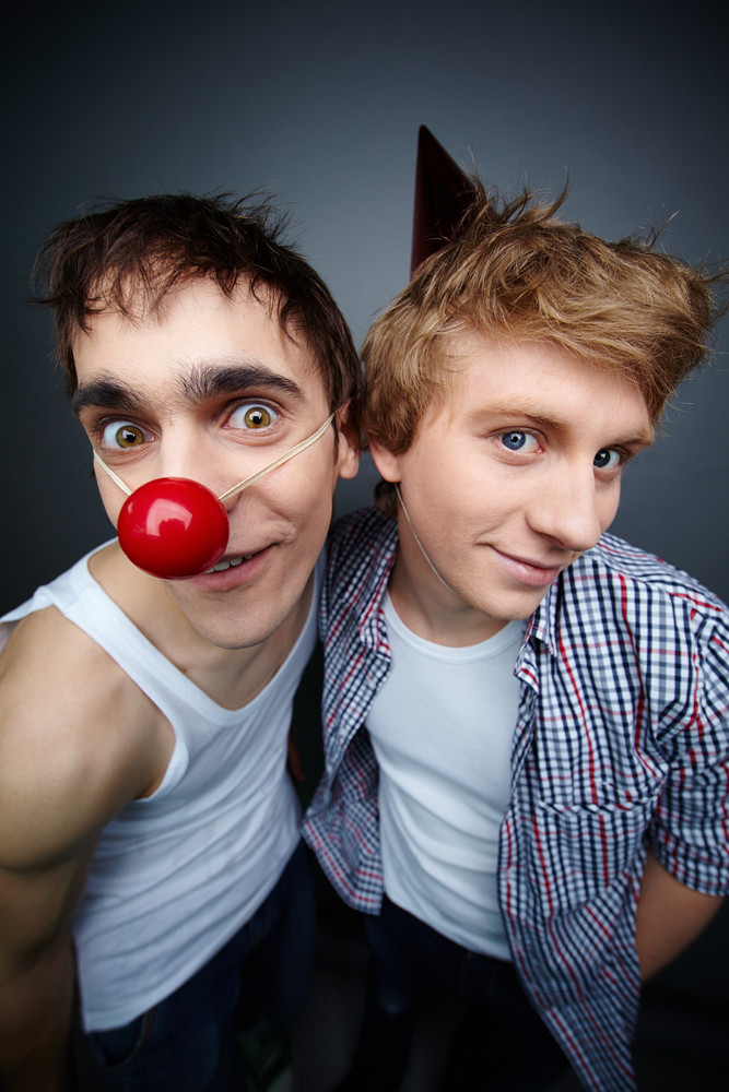 Two Guys Having Fun Making Faces At Camera On Fool