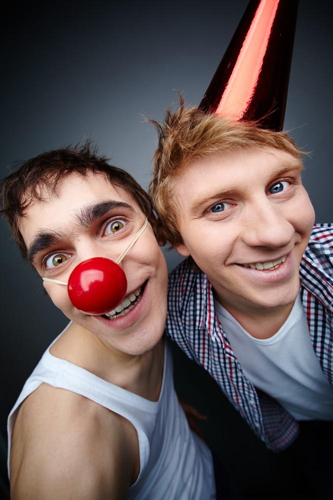 Two Guys Having Fun Making Faces At Camera On Fool