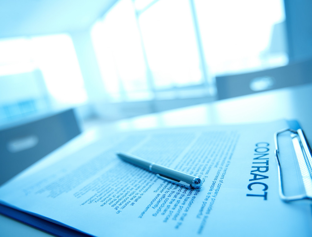 Image Of Business Contract And Pen On Table