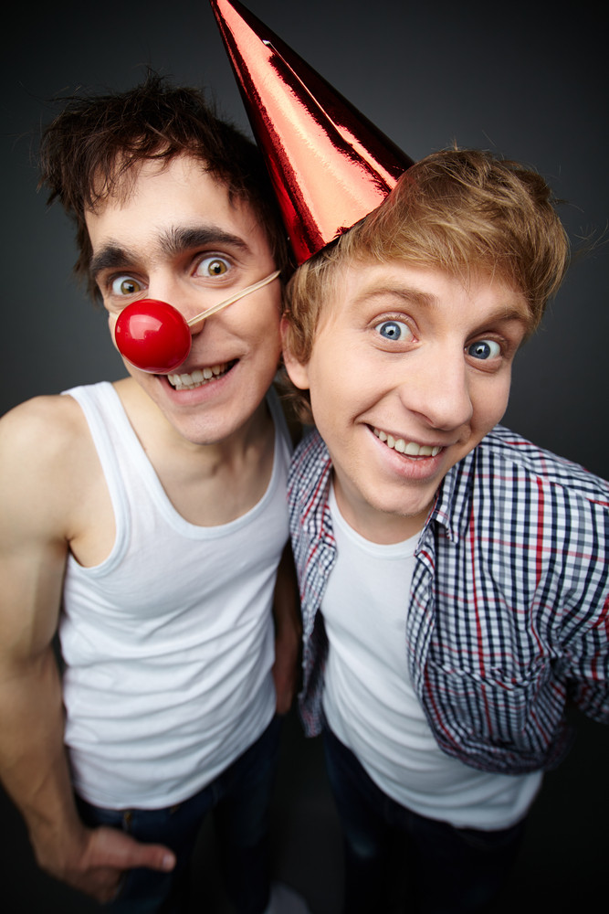 Two Funny Guys Looking At Camera And Smiling Crazily