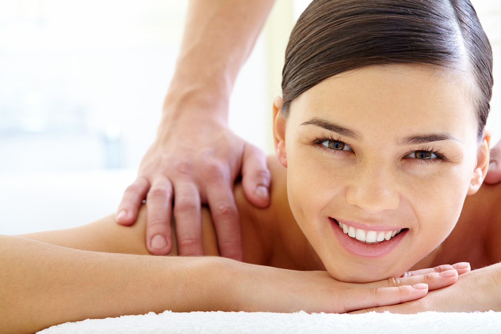 Smiling Female Looking At Camera During Luxurious Procedure Of Massage