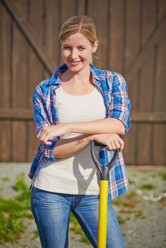 Image Of Happy Female Farmer With Instrument Looking At Camera