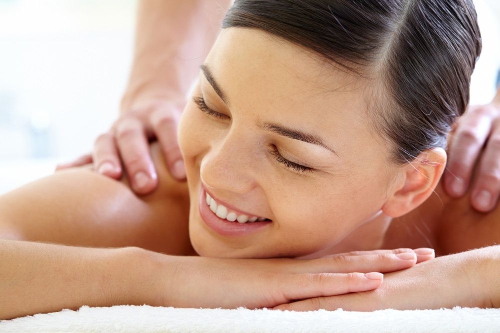 Smiling Female Enjoying Procedure Of Massage