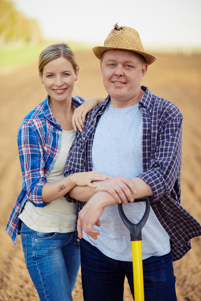 Image Of Two Happy Farmers Looking At Camera With Smiles