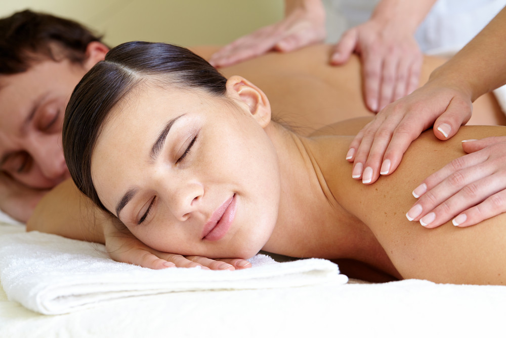 Close-up Of Calm Female And Male Taking Pleasure During Massage