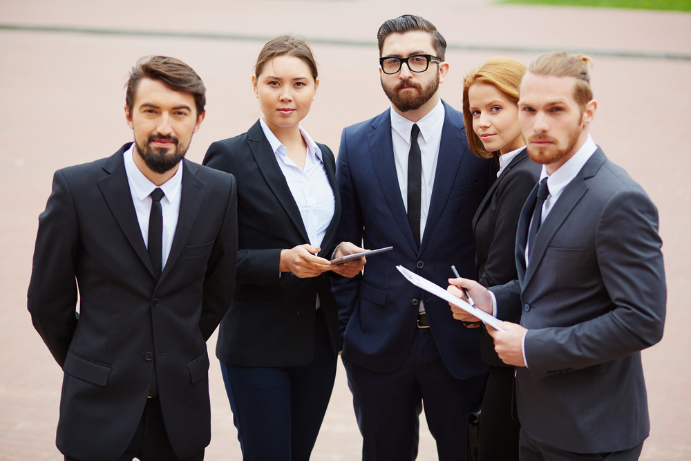 Group Of Elegant Business Partners Looking At Camera