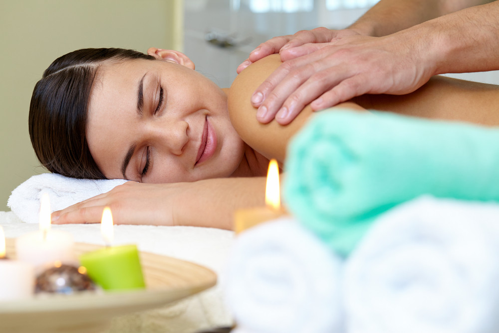 Portrait Of Young Female Lying In Spa Salon And Enjoying The Procedure Of Massage