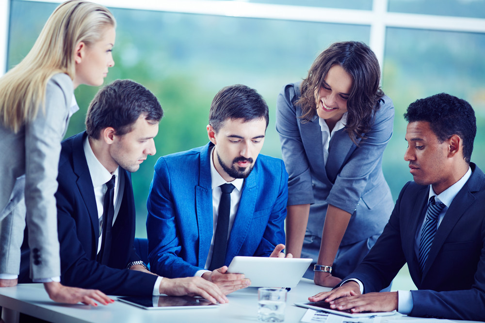 Several Confident Employees Gathered At Workplace Discussing Data